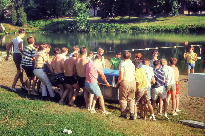 1971 Catapult students carry the newly constructed raft to the lake. The raft was constructed by counselors.