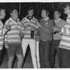 Russ Rubberguts White, Prince Nigel Kay, Mick Muncha Coutts, Arthur Arfabrain Verster, Damian Tic Curry and Ray Sacky McDonald.