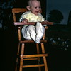 Kristi in doll high chair, January 1971, Lincoln, NE