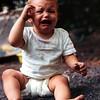Not a happy camper. Kristi camping at Sleepy Creek, WV, July 1971