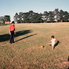 Scott playing soccer with Uncle Paul, Nebraska, June 1976