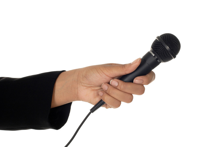 Microphone in Woman's Hand