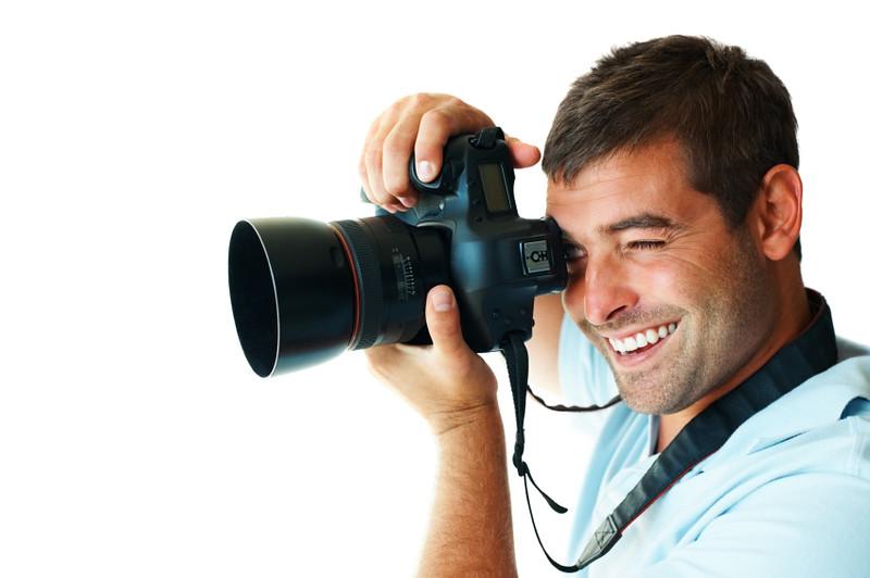 Happy photographer isolated on white background