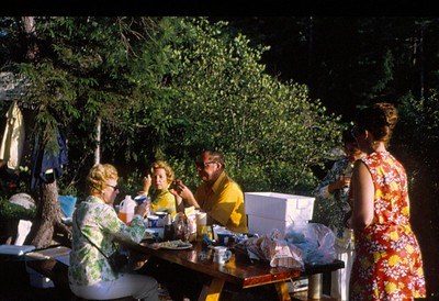 Arthur Weiss (center) and Corky Weiss (print dress) and friends, Picnic Island, 1970's