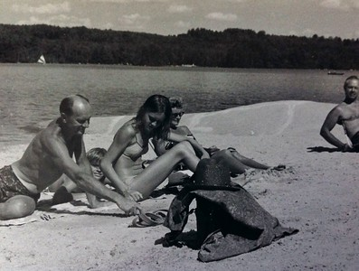 """Relaxing by the """"whaleback"""" at the beach, 1971"""