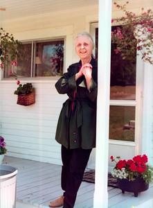 Joanna Benjamin on front porch, 1978