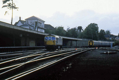 Easily distinguishable by its whit cab window surrounds, 33101 has shunts across into the sidings at Bournemouth to await the arrival of the next 'Down' working having propelled an early evening Waterloo-bound train from Weymouth (26/08/1982)