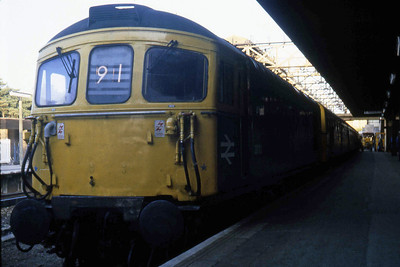 33113 awaits departure from Bournemouth having coupled to the 4TC set to work forward over the non-electrified section to Weymouth on an early evening departure from Waterloo (26/08/1982)