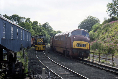 D821 'Greyhound' passes D9529 outside the Motive Power Depot as it arrives at Grosmont with a train from Pickering (??/07/1982)