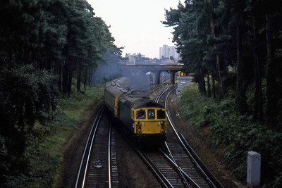 33109 departs Bournemouth for Weymouth with a late-afternoon 'Down' working from Waterloo (27/08/1982)
