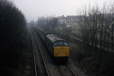 An unidentified 'Peak' is pictured on the approach to Bingley with a Nottingham - Glasgow working during the first week of April 1982