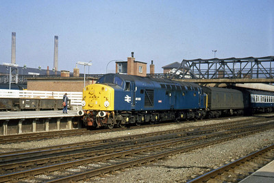 Sporting a hand-painted version of the 'Lusitania' nameplate it formerly carried, 40025 passes through Doncaster with the Cleethorpes - Manchester (Red Bank) empty parcels (19/04/1982)