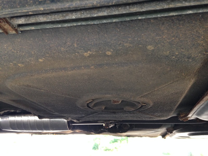 Underbody metal is relatively clean.