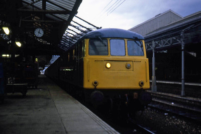 85038 pauses at Crewe with an unidentified 'up' working (10/01/1983)