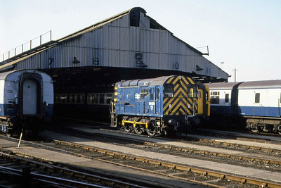 09020 is seen here on pilot duty outside the carriage shed at Clapham Junction (22/02/1983)