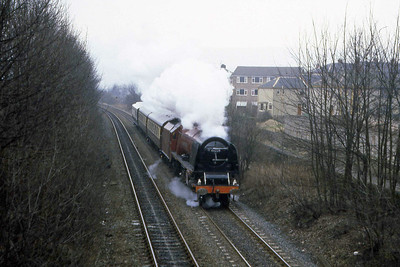46229 'Duchess of Hamilton' approaches Bingley with two Pullman coaches and a Saloon in tow. The photo is undated but possibly Sunday 20 March 1983 after working the SLOA 'Cumbrian Mountain Pullman' the previous day