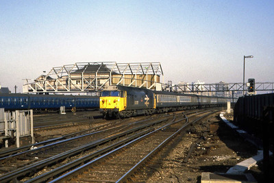50025 'Invincible' speeds through Clapham Junction with 1Vxx 1310 Waterloo - Exeter St Davids (22/02/1983)