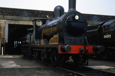 Built by the lancashire & Yorkshire Railway in 1896, Class 27 0-6-0 no. 1300 is seen here in the company of 34092 outside the shed at Steamtown, Carnforth (07/07/1983)