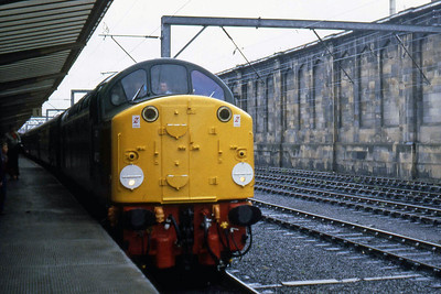 Making its debut passenger working following a lengthy restoration into near-original condition, pioneer 40122 arrives at Carlisle with the 1Z12 1553 Warcop Sidings to London Euston 'Hadrian Pullman' Railtour (31/07/1983)