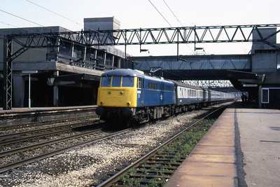 85016 heads through Stafford with an unidentified northbound working (22/07/1983)
