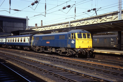 86214 'Sans Pareil' pauses at Carlisle with an unidentified southbound working (26/04/1984)