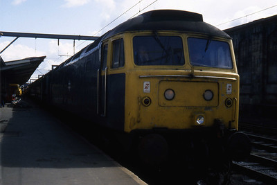 47463 is pictured on arrival at Carlisle with 1S41 1005 Manchester Victoria - Glasgow Central having worked the train from Preston over the Settle & Carlisle route (15/04/1984)