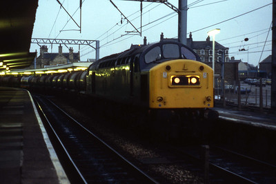 40181 pauses at Carnforth with what looks like the Corkickle tanks (Ian Ward: 28/01/1984)