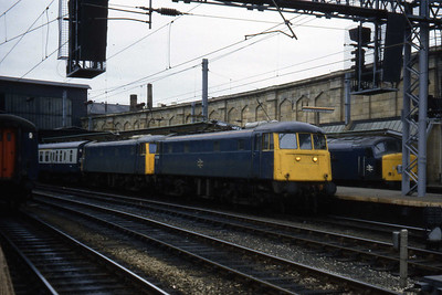 85008 + 81010 pause at Carlisle with an unidentified southbound working (18/04/1984)