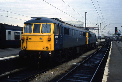86037 + 87007 are seen here stabled in Platform 2 at Wigan North Western (18/04/1984)