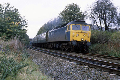 47465 approaches heads away from Bingley at the former Southfield Lane foot crossing with 1E23 1040 Carlisle - Leeds (25/10/1984)