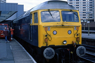 An unusual visitor to West Yorkshire on the first 'Winter' Saturday was 47705 'Lothian', seen here waiting to depart from Leeds with 1M26 1555 to Carlisle (06/10/1984)