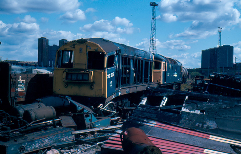 20207 + 27027 are not long for this world amoungst a pile of scrap metal in St Rollox Works Glasgow 05/08/84