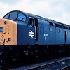 """40162 at Haymarket depot 03/08/84. This loco stood in this location for many years and was missing a wheelset. The words """"Save me"""" were added to the yellow ends for many years but regrettable did not work as the loco was eventually scrapped."""