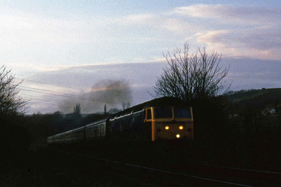 47445 approaches Bingley signal box with an additional 1Zxx 1615 Carlisle - Leeds relief (30/03/1985)