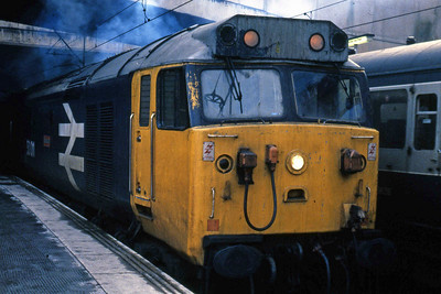 50011 'Centurion' stands at Birmingham New Street after arriving from Reading with 1E63 0940 Poole - Newcastle (26/01/1985)