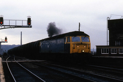 47059 heads west through Huddersfield with a train of oil tanks (19/04/1985)