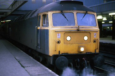 Covering for the booked HST, 47143 calls at Leeds with 1Exx 1340 Paignton - Newcastle (19/04/1985)