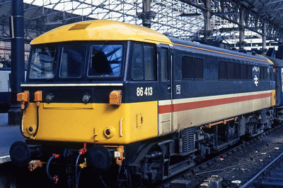 An immaculate 86413 is pictured on arrival at Manchester Piccadilly with 1Hxx 1150 from London Euston (21/04/1985)