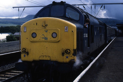 37263's boiler is clearly working as it waits for the 'right away' from Dumbarton with 1Y21 0950 Glasgow Queen Street - Fort William (19/08/1985)
