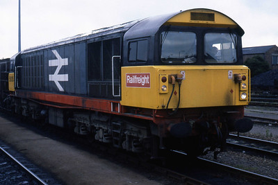 58005 passes Peterborough with an empty fly-ash train from Fletton (07/08/1985)