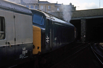 With a failed 45127 in tow, 47528 departs Huddersfield with the late-running 1M62 0710 Newcastle - Liverpool (05/10/1985)