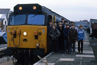 Members of the Bradford Grammar School Transport Society and friends pose alongside 50028 at Paignton (03/01/1986)