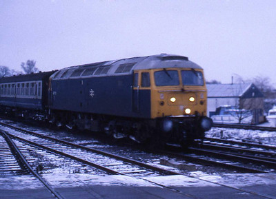 47573 arrives at Ely with the 0700 Kings Lynn-Liverpool Street (08/02/1986)