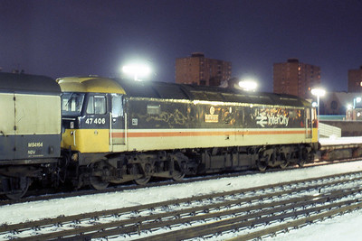 47406 'RailRiders' is pictured in the early hours of Saturday morning at Doncaster with an 'up' van train (08/02/1986)
