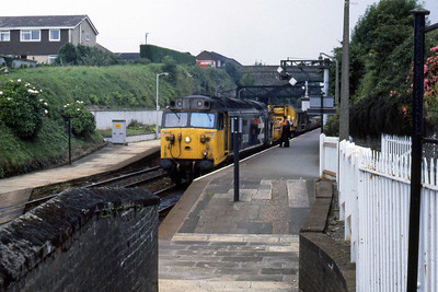 50013 'Agincourt' stands at Liskeard with an engineering train en route towards Plymouth (12/08/1986)