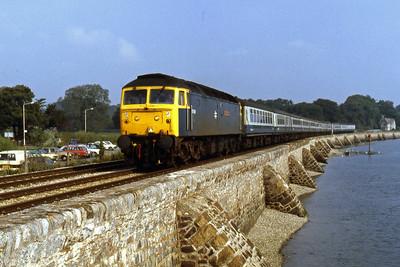 47559 'Sir Joshua Reynolds' runs alongside the Exe estuary into Starcross with 2C11 0935 Exeter Paignton (12/08/1986)