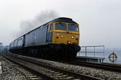 After restarting from Starcross, 47473 is pictured at Cockwood Harbour with the 0935 Exeter-Paignton (11/08/1986)