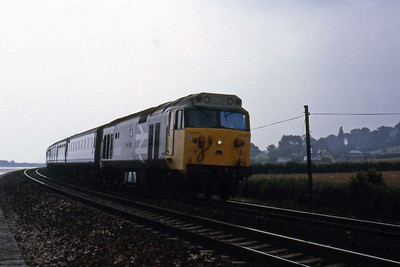 50026 'Indomitable' approaches Cockwood with the 1030 Penzance - Liverpool (11/08/1986)