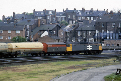 47211 waits for the road at Holgate Junction, York, with a southbound train of ICI tanks (22/05/19987)