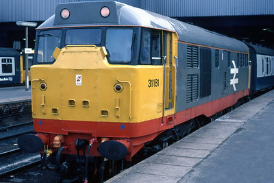 On the first 'Summer saturday' of 1987, red-stripe Railfreight-liveried 31181 waits to depart from Leeds with 1D20 0920 to Skegness (16/05/1987)